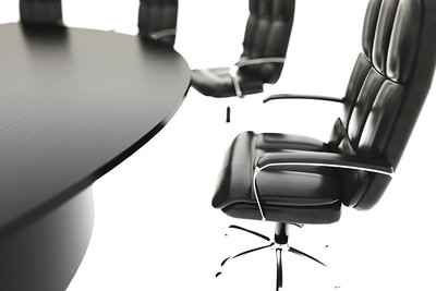 Black Boardroom Table Against a White Background