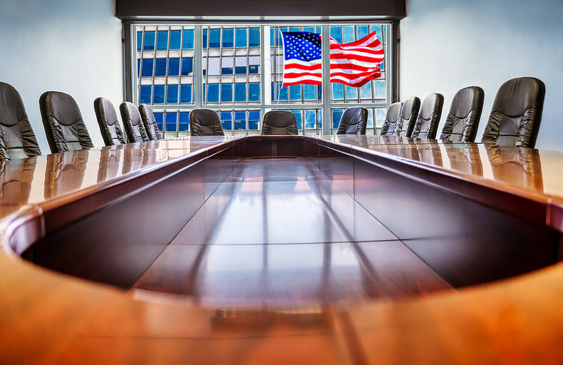 Boardroom Table with USA Flag Outside of Window