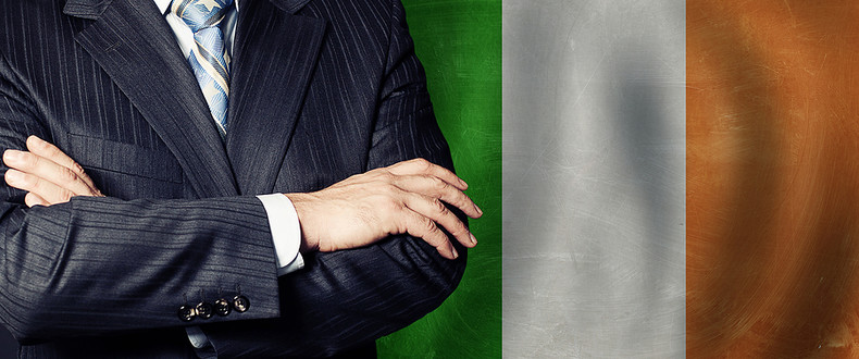 Business Man with Crossed Arms Against Ireland Flag