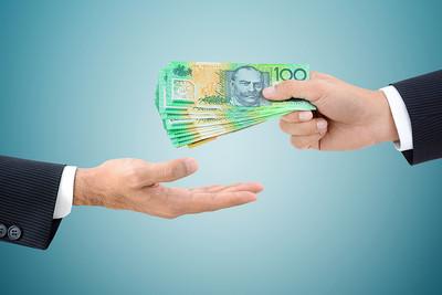 Businessman Passing Australian 100 Dollar Bills