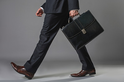 Businessman Walking Holding Briefcase