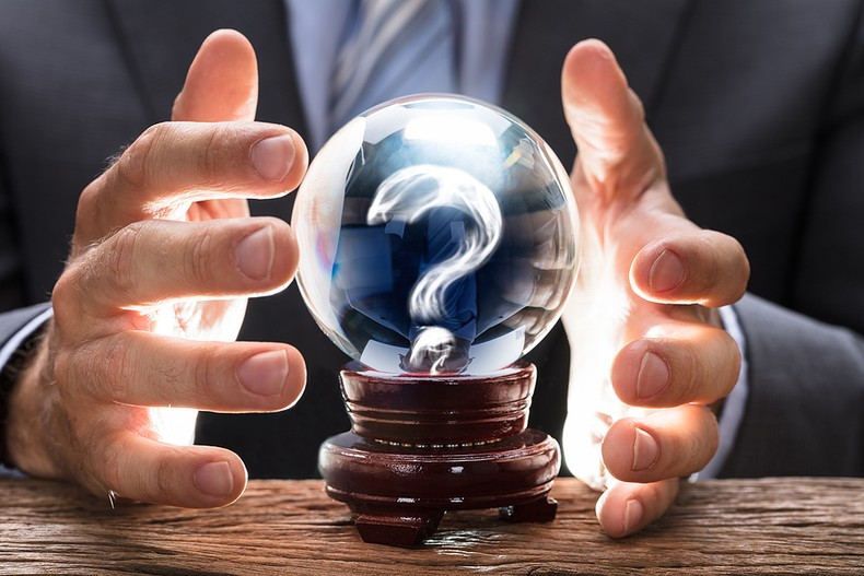 Businessman with Question Mark Crystal Ball