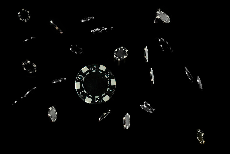 Casino Chips Falling Against a Black Background