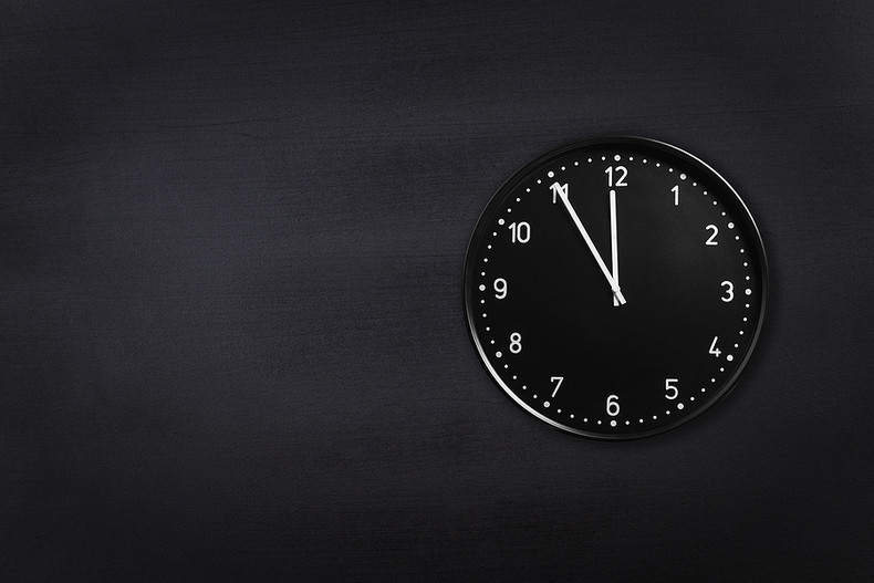 Clock Showing Five to Midnight