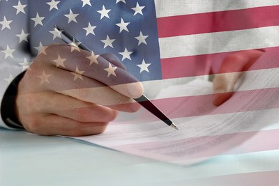 Contract Signed Against USA Flag