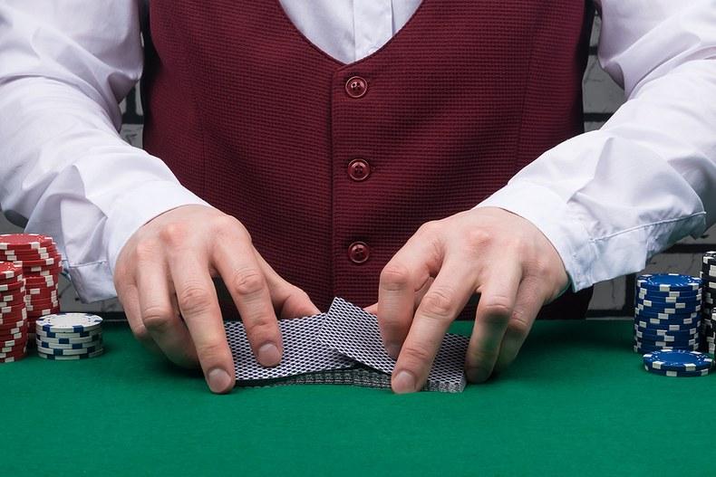 Croupier Shuffling Cards