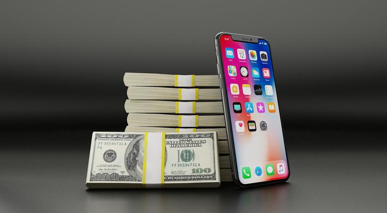 Dollar Bill Stacks and Smartphone