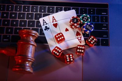 Gavel and Casino Chips on Laptop