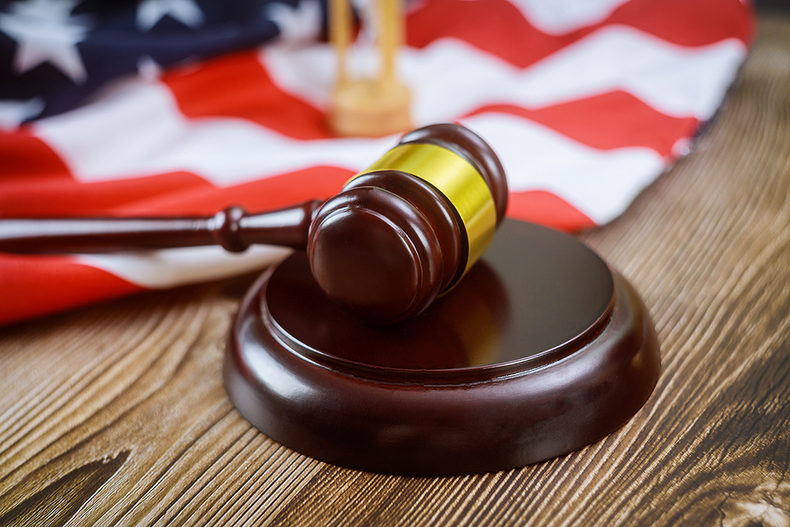 Gavel on Wooden Desk with USA Flag