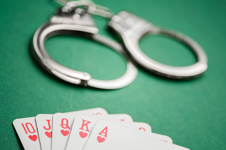 Handcuffs on Poker Table