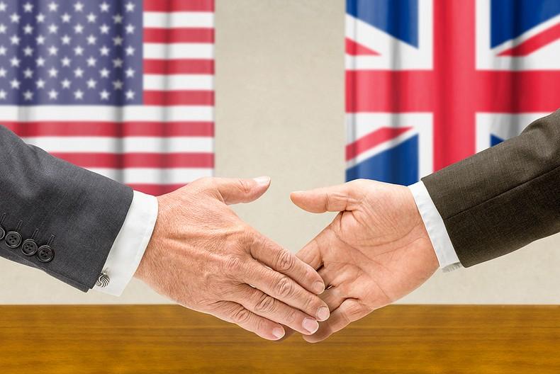 Handshake with USA and UK Flags