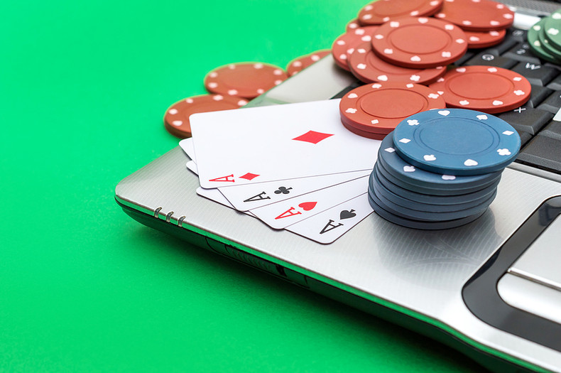 Laptop with Poker Chips and Cards