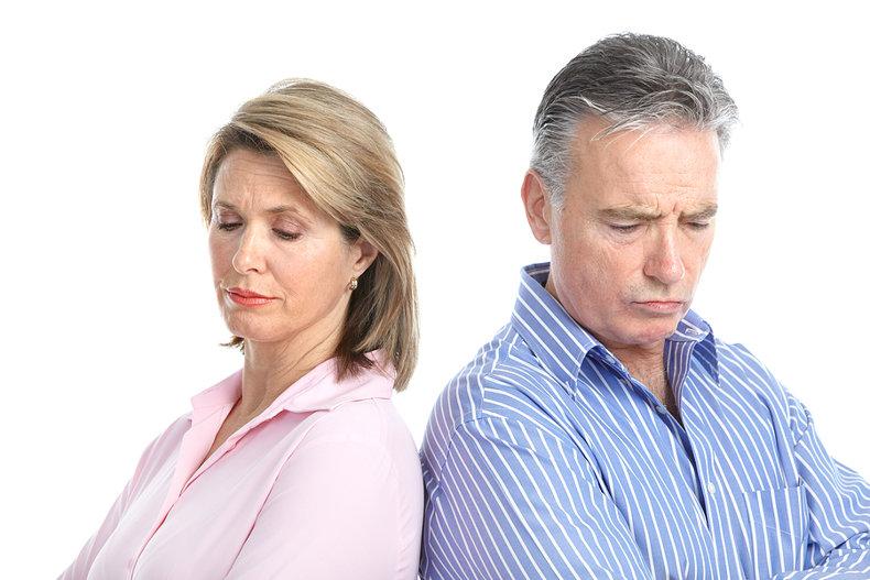 Man and Woman Looking Sad