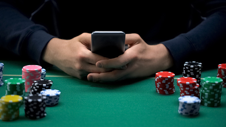 Man with Mobile Phone at Casino Table