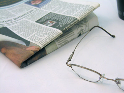 Reading Glasses and Newspaper
