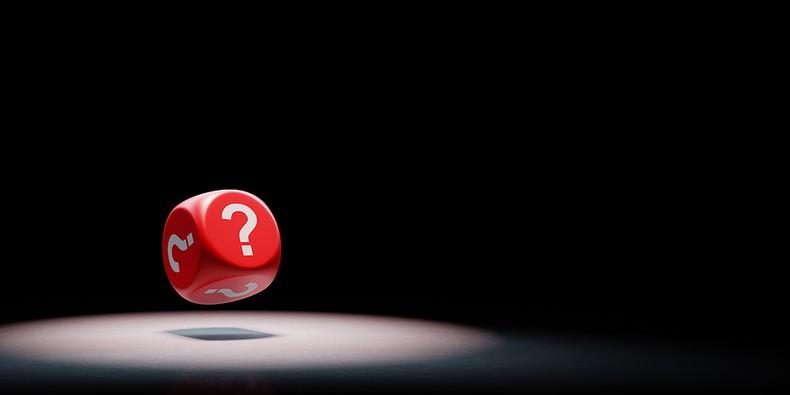 Red Question Mark Dice Under Spotlight