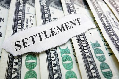 Settlement Paper Cutting on Dollar Bills