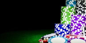 Stacks of Casino Chips on Darkened Table