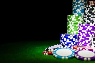 Stacks of Casino Chips on Darkened Table