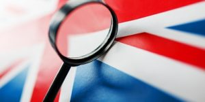 UK Flag and Magnifying Glass