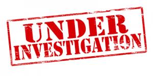 Under Investigation Stamp