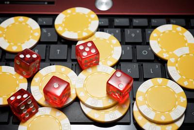 Yellow Casino Chips on Laptop Keyboard